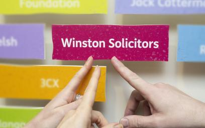 Leeds Mencap presented Winston Solicitors with their supporters brick