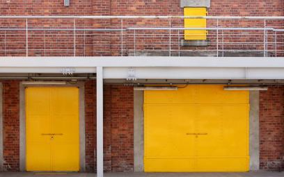 yellow shutters outside a commercial building
