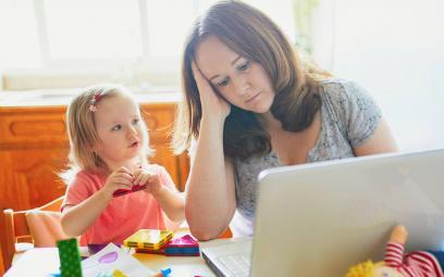 mother working from home looking after child